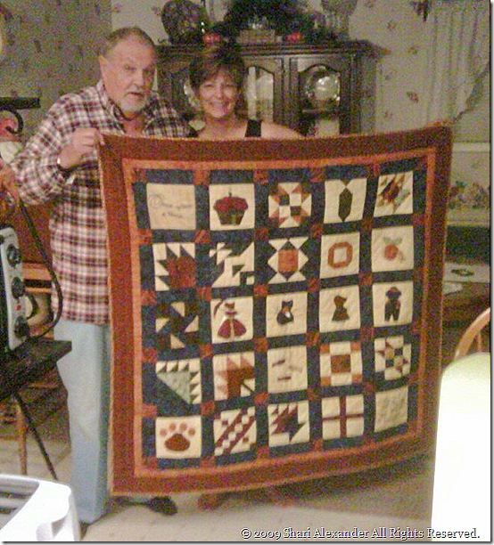 Shari and her Dad & his quilt